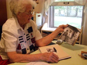Gail Martin shows copies of her new book, My Flint Hills Childhood (photo courtesy of The El Dorado Times newspaper)
